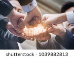 business people team joining... | Shutterstock . vector #1039882813