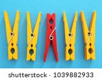 clothes pegs and one different...   Shutterstock . vector #1039882933