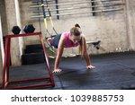 fitness woman doing push ups in ... | Shutterstock . vector #1039885753