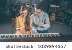 piano teacher giving lessons to ... | Shutterstock . vector #1039894357