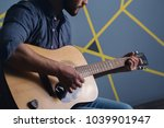 Bearded Man Playing The Guitar...