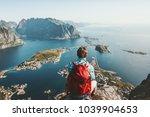 man sitting on cliff edge alone ...   Shutterstock . vector #1039904653