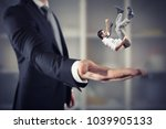 businessman is saved from a big ... | Shutterstock . vector #1039905133