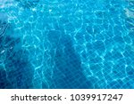underwater in a swimming pool... | Shutterstock . vector #1039917247