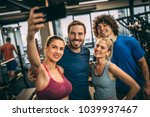 friends having fun at the gym.... | Shutterstock . vector #1039937467