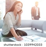 woman assistant at the... | Shutterstock . vector #1039942033