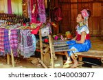 long neck woman working on a... | Shutterstock . vector #1040003077