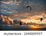kitesurfing at sunset  kite... | Shutterstock . vector #1040009557
