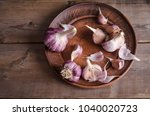 garlic in the plate on old...   Shutterstock . vector #1040020723