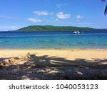 scene of tranquility island ... | Shutterstock . vector #1040053123
