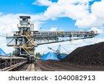 coal stacker and coal reclaimer ... | Shutterstock . vector #1040082913