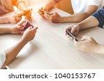 hands using phone in office...   Shutterstock . vector #1040153767