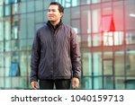 portrait asian man wearing coat ... | Shutterstock . vector #1040159713