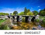 the ancient clapper bridge at...   Shutterstock . vector #104016017