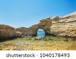 stone arch. white cliffs. sea... | Shutterstock . vector #1040178493