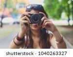 girl photographer taking photo... | Shutterstock . vector #1040263327