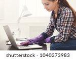 woman cleaning laptop keyboard. ...   Shutterstock . vector #1040273983
