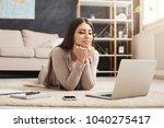 thoughtful girl chatting online ... | Shutterstock . vector #1040275417