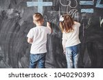cute little girl and boy... | Shutterstock . vector #1040290393