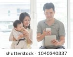 chinese man scanning qr code... | Shutterstock . vector #1040340337