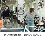 young pair choosing sport... | Shutterstock . vector #1040346433