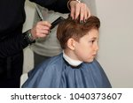 a handsome boy is made to...   Shutterstock . vector #1040373607