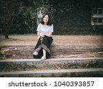 pretty woman sitting on stump ... | Shutterstock . vector #1040393857