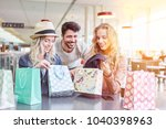group of friends shopping at... | Shutterstock . vector #1040398963