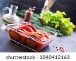 ratatuille with tomato sauce in ... | Shutterstock . vector #1040412163