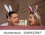 happy easter. joyful couple... | Shutterstock . vector #1040412967