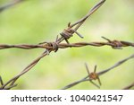 barbed wire fence | Shutterstock . vector #1040421547