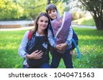 young mom  carrying newborn in... | Shutterstock . vector #1040471563