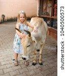 little girl  beautiful cow   Shutterstock . vector #1040500573