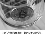 bitcoin in a glass on laptop... | Shutterstock . vector #1040505907