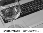 bitcoin in a glass on laptop... | Shutterstock . vector #1040505913