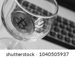 bitcoin in a glass on laptop... | Shutterstock . vector #1040505937