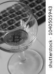 bitcoin in a glass on laptop... | Shutterstock . vector #1040505943