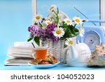 Tea With Flowers On The Blue...