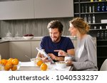 a couple in the kitchen looks... | Shutterstock . vector #1040533237