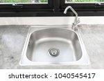 kitchen sink stainless steel... | Shutterstock . vector #1040545417