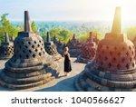 Small photo of Borobudur, greatest Buddhist temple - Java, Indonesia.