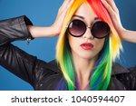 beautiful woman wearing color...   Shutterstock . vector #1040594407