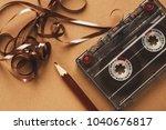 retro audio cassette and pencil ... | Shutterstock . vector #1040676817