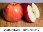 three red apples with shadow on ... | Shutterstock . vector #1040703817