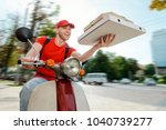 joyful man is delivering pizza. ... | Shutterstock . vector #1040739277