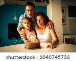 happy family blowing birthday... | Shutterstock . vector #1040745733