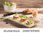 canapes with smoked salmon and... | Shutterstock . vector #1040769403