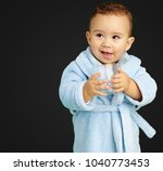 portrait of baby boy holding a...   Shutterstock . vector #1040773453