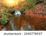 magnificent autumn sunrise ... | Shutterstock . vector #1040778937