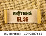 Small photo of Writing text showing Anything Else. Business photo showcasing Ask Asking Question to Have Answer written Tear Sticky Note Paper the textured background